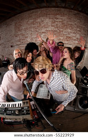 Singing DJsat a 1970s Disco Music Party - stock photo