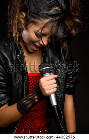 Singing Mexican Girl - stock photo