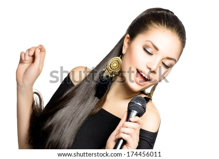 Singing Woman. Beautiful Singing Girl. Beauty Woman with Microphone over White Background. Singer. Karaoke song. - stock photo