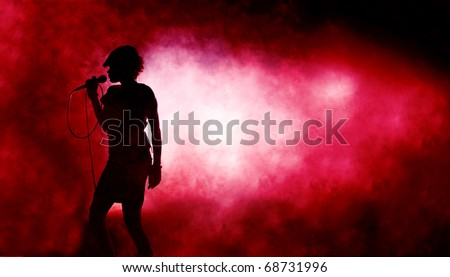 Singing woman silhouette with red background full of smoke - stock photo