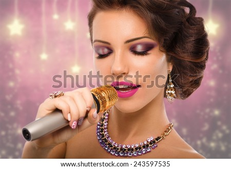 Singing Woman with Microphone. Beauty Glamour Singer Girl Portrait. Vintage Style. Karaoke Song - stock photo