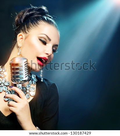 Singing Woman with Retro Microphone. Beauty Glamour Singer Girl. Vintage Style. Song - stock photo