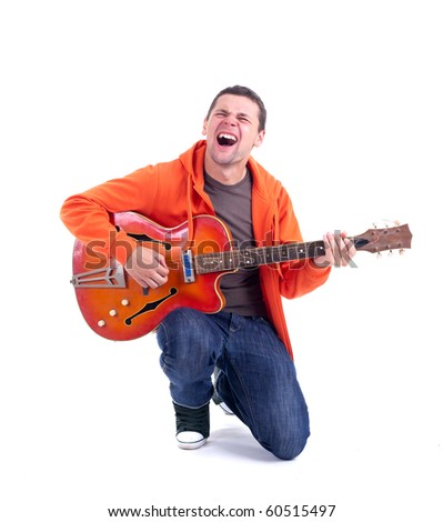 singing young man playing on electric guitar - stock photo