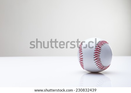 single base ball shot in the studio on white perspex background - stock photo