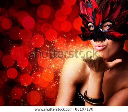 single beautiful woman in carnival mask - stock photo