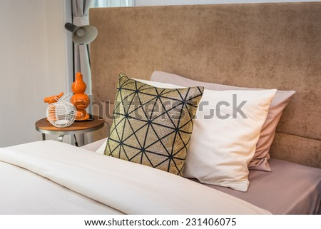 single bed with bedside tables and reading lamp - stock photo