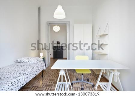 Single bedroom in modern apartment - stock photo