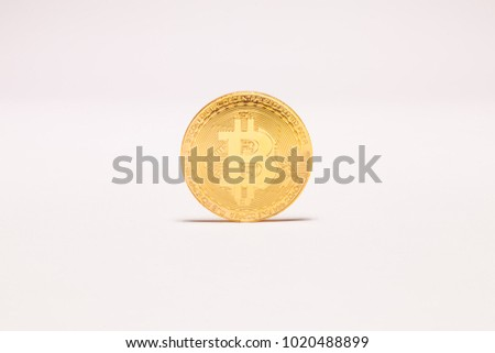 Single Bitcoin on white background