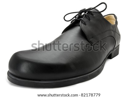 single black business leather shoe shot with wide angle lens. White background - stock photo