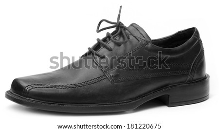 Single black shoe over white background