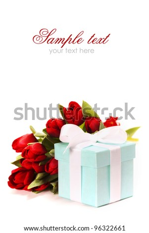 Single blue gift box with white ribbon and flowers on white background  (with sample text) - stock photo