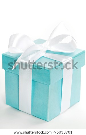 Single blue gift box with white ribbon on white background. - stock photo