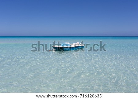 Single boat on the background of the sea.
