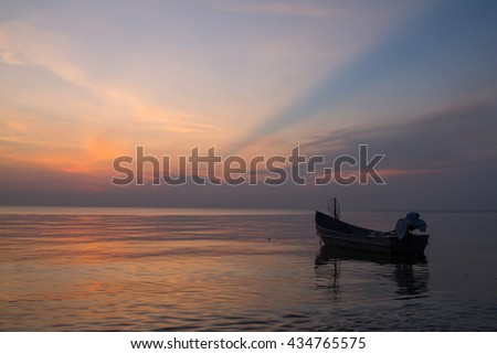 Single Boat with Burning Sky During Sunrise