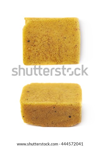 Single bouillon stock broth cube isolated over the white background, set of two different foreshortenings