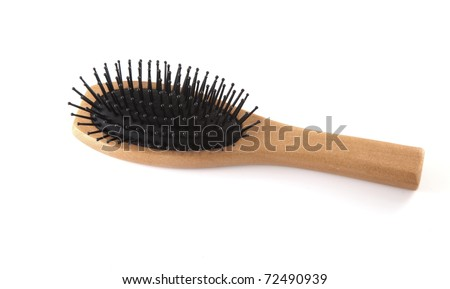 Single brown hair brush on a white background. - stock photo
