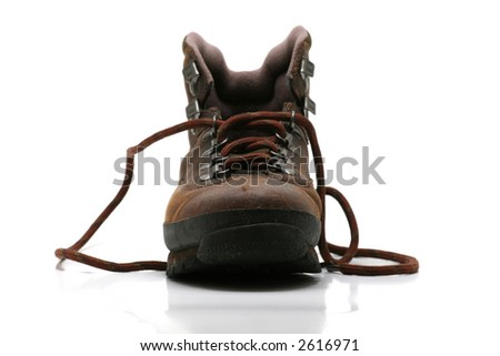 Single brown hiking boot, frontal view, on white background. - stock photo