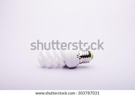 Single Bulb on white background - stock photo