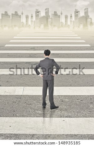 Single businessman look and stand in the road of city. - stock photo