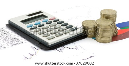 Single calculator and heap of coins on a stock-diagram. Business stil-life
