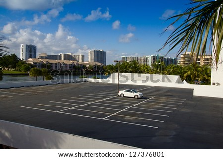 Single car on a parking lot - stock photo