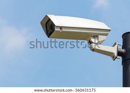 Single CCTV Security camera on clear sky background