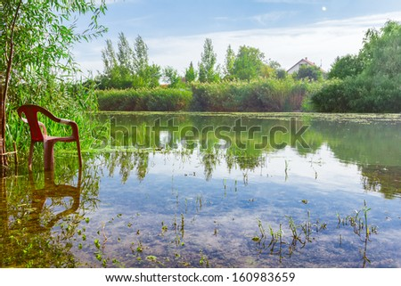 Single chair facing the calmness and relaxation in a beautiful environment. - stock photo