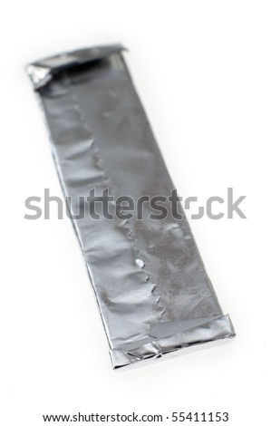 single chewing gum wrapped in standard silver foil, isolated on white background - stock photo