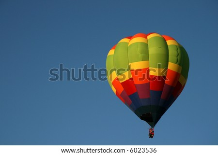 Single, colorful hot air balloon, early morning