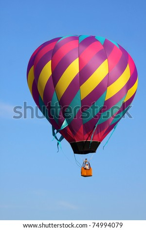 Single colorful hot air balloon in air - stock photo