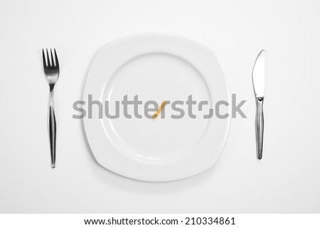 Single cracker on the middle of a plate, knife and fork.