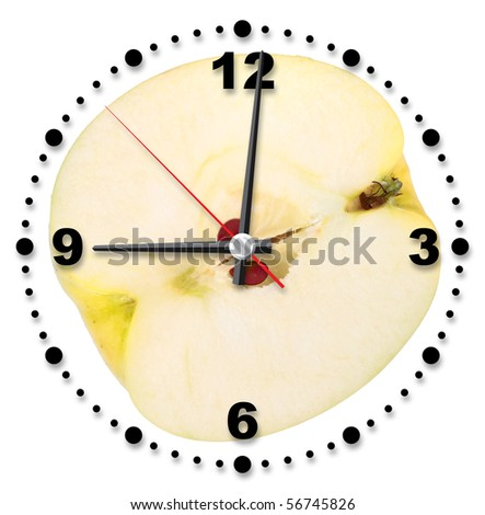 Single cross of yellow apple as a office clock. Close-up. Studio photography.