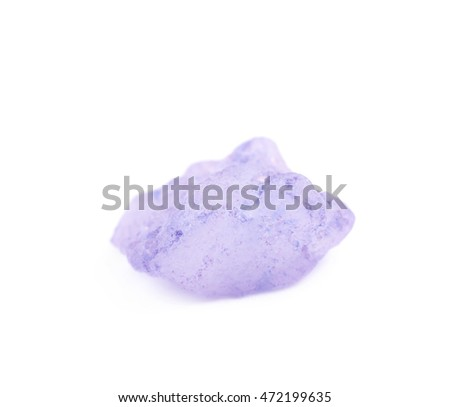 Single crystal of salt isolated over the white background, macro close-up shot with the shallow depth of field