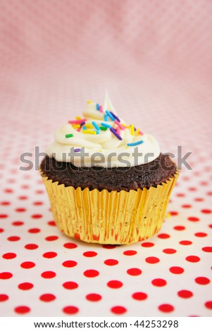 Single cup cake with candies on top