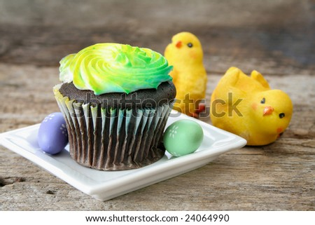 Single cupcake on a plate with Spring surroundings. - stock photo