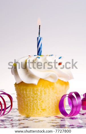 Single cupcake with Blue Candle - stock photo