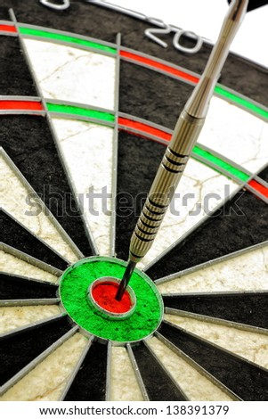 Single dart hitting the Bullseye of a dart board