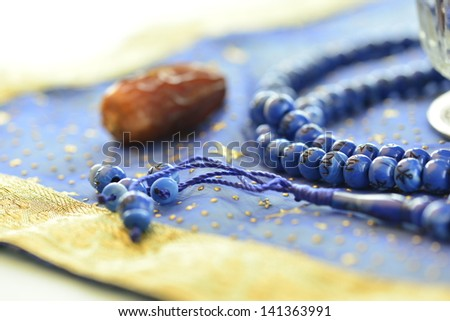 Single date and rosary close up - stock photo