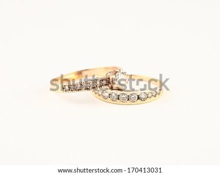 Single diamond ring on white - stock photo