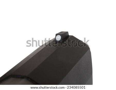 Single dot on the front sight of a semi automatic handgun - stock photo