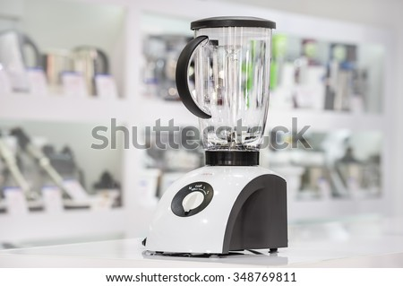 single electric blender at retail store shelf, defocused background