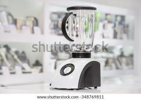 single electric blender at retail store shelf, defocused background - stock photo