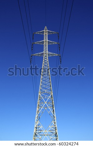 Single electricity transmission tower - stock photo