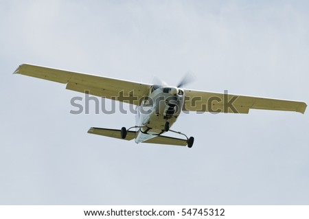 Single engine airplane against a clear sky - stock photo