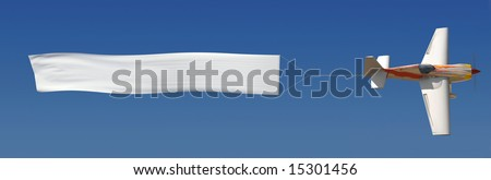 Single engine plane flying a blank banner against a blue sky - stock photo