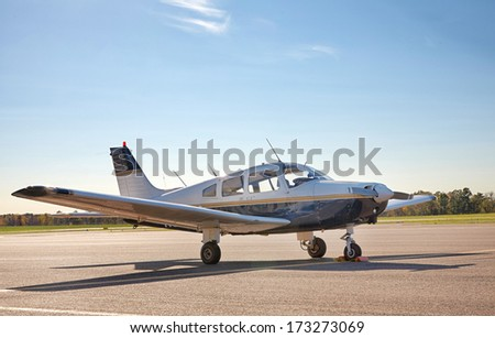 Single-engine plane on the airfield    - stock photo
