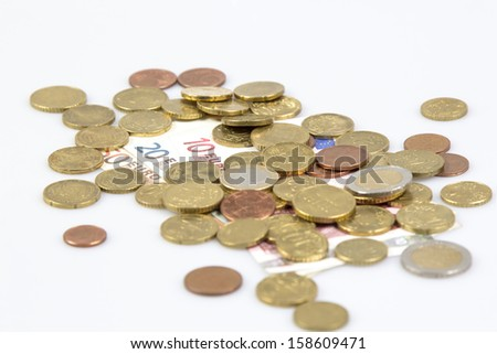 Single Euro coins and some notes isolated on white background