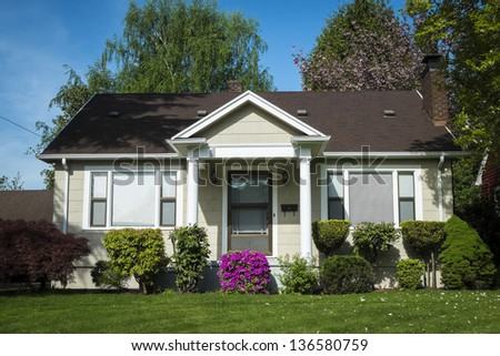 Single-family American craftsman house with blue sky background - stock photo