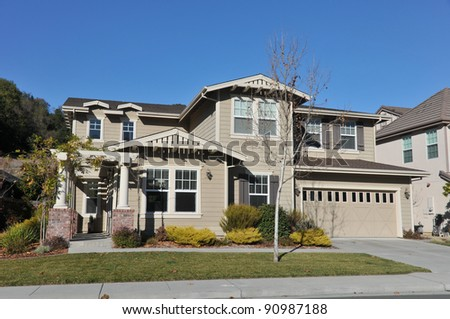 Single family house with two stories and a short driveway