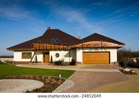 Single family modern white house against blue sky - stock photo